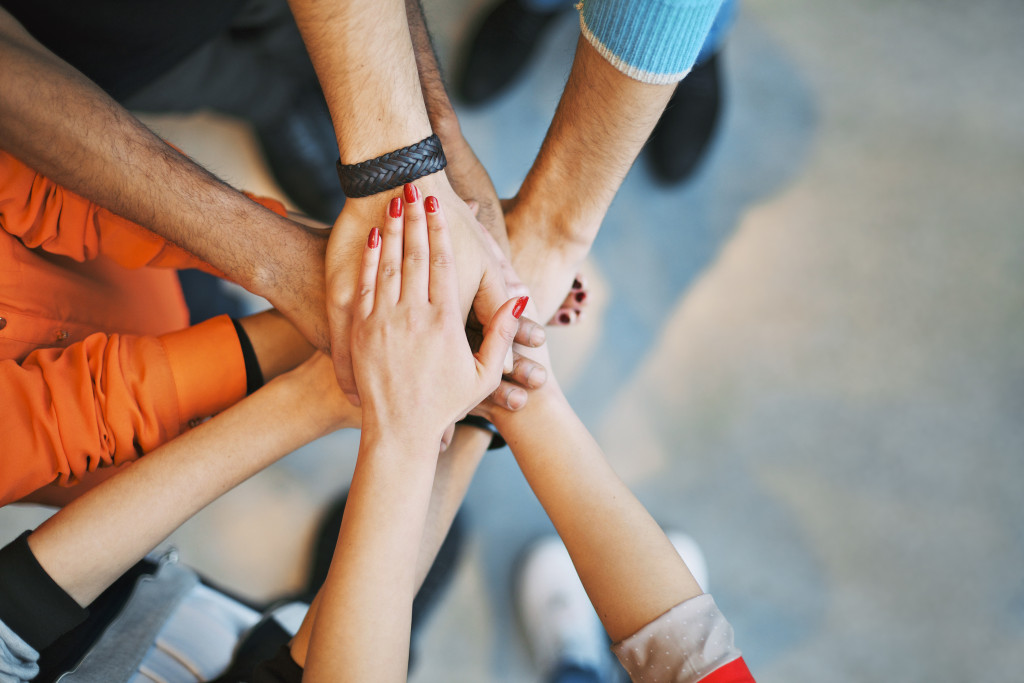 community teamwork and support hands